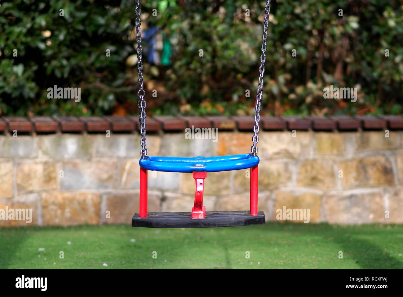 A swing in the playground. Stock Photo