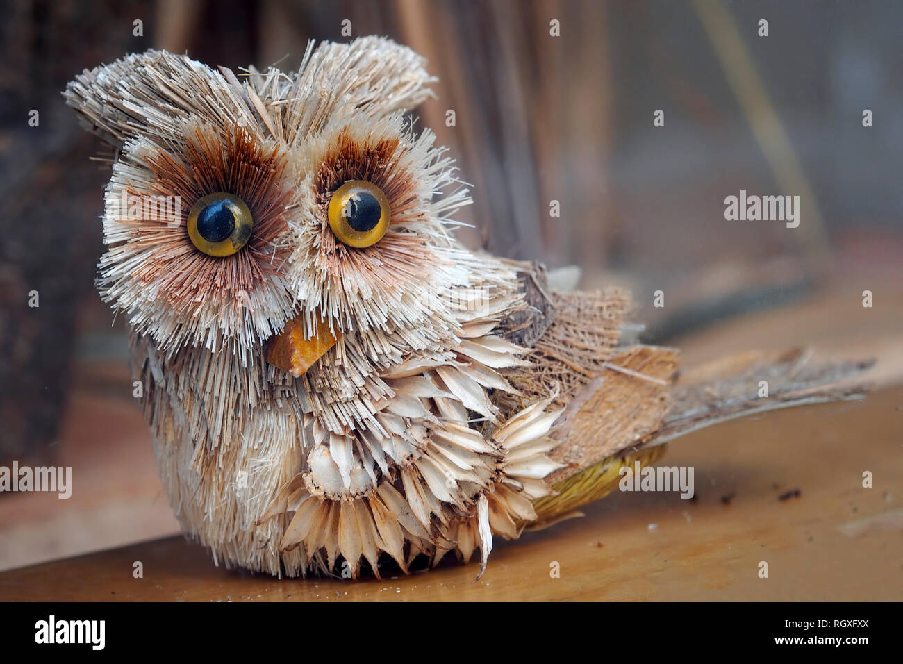 Artwork. Wooden owl with very curious eyes. Stock Photo