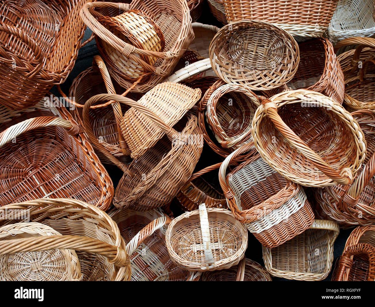 Pile of wicker baskets on sale in public street market. Stock Photo