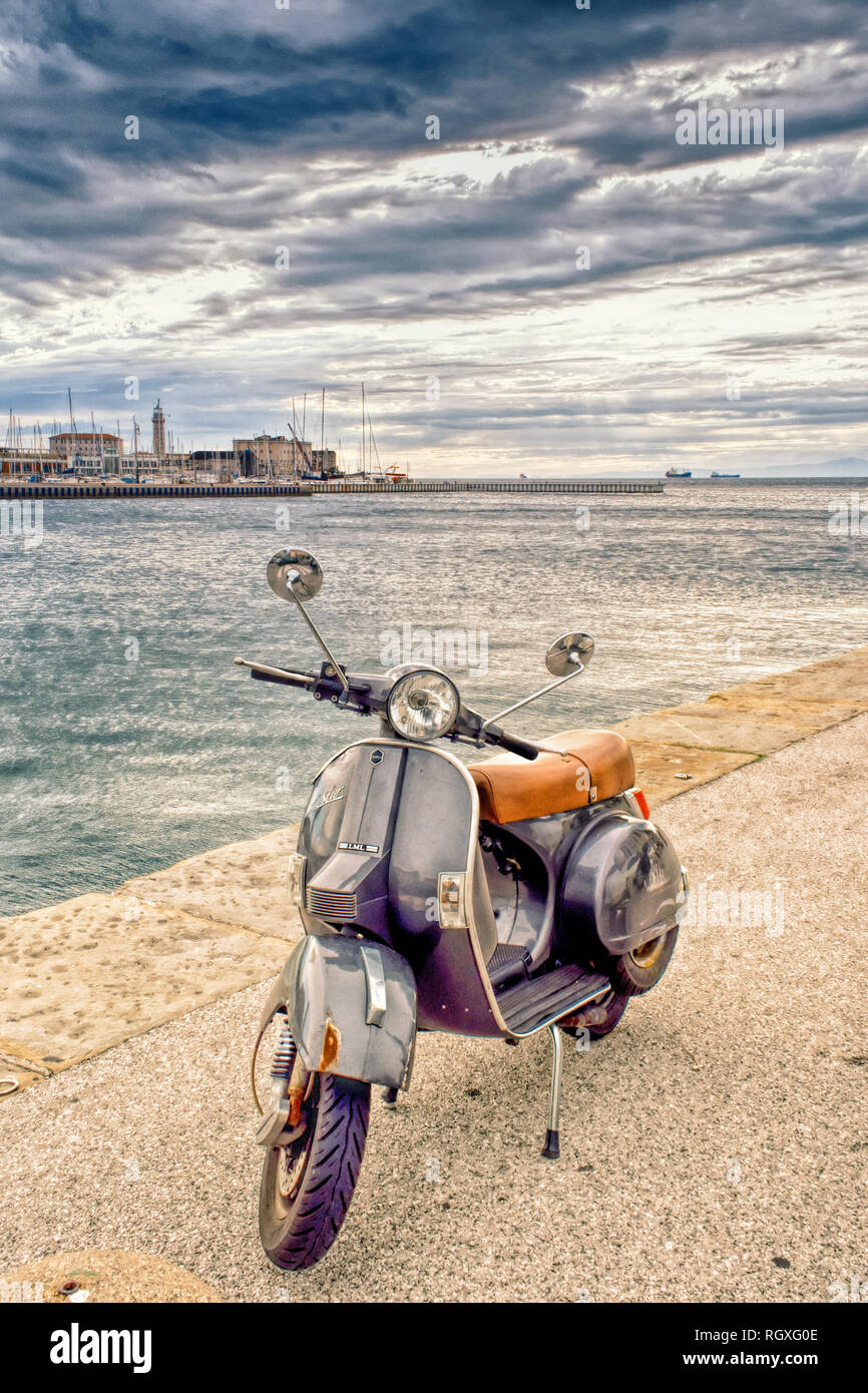 Trieste. Italian scooter VESPA parked on the pier. Stock Photo