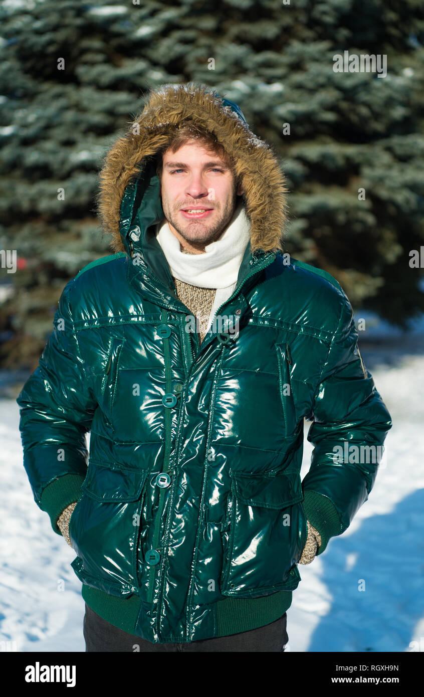89de67bd614b1 Winter fashion. Warm clothes. man on winter holidays. Snowy weather. Trendy  winter