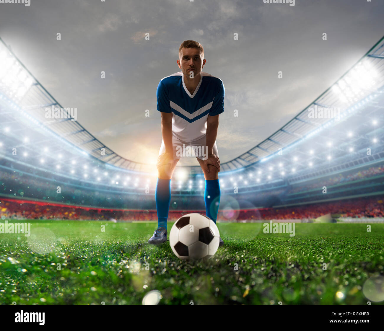 Soccer player ready to kick the soccerball at the stadium during the match - Stock Image