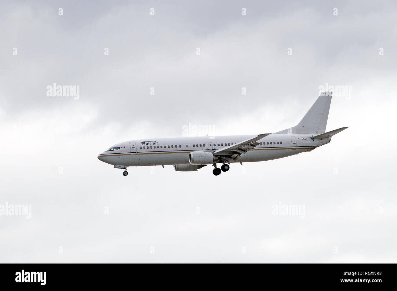 Flair air airplane coming in for a landing at Vancouver International Airport,  Vancouver, British Columbia, Canada - Stock Image