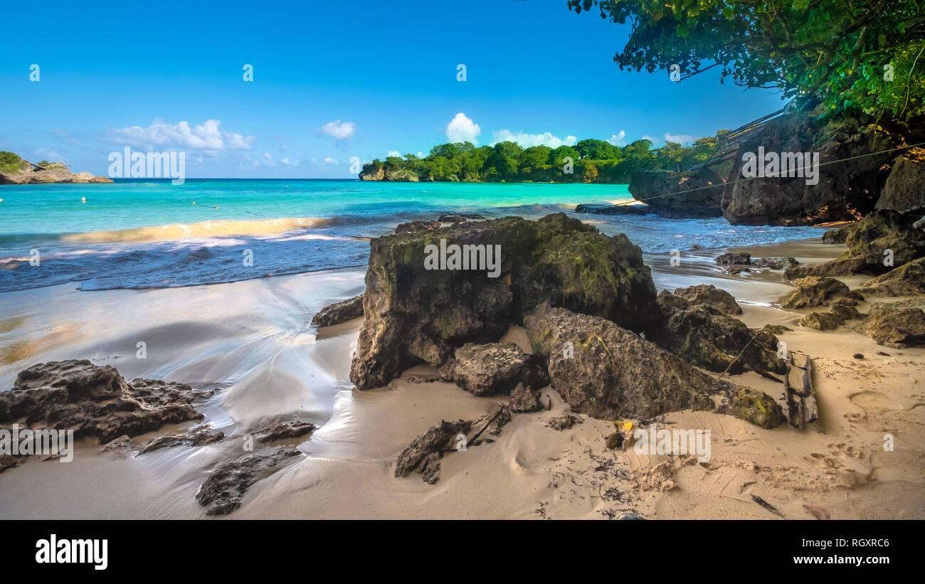 Jamaica Beach Ocean Landscape Beachscape Sand Tropics Caribbean Colorful Boston Bay Portland Rocks Waves Green Water Blue Water Sky Foreign Island - Stock Image