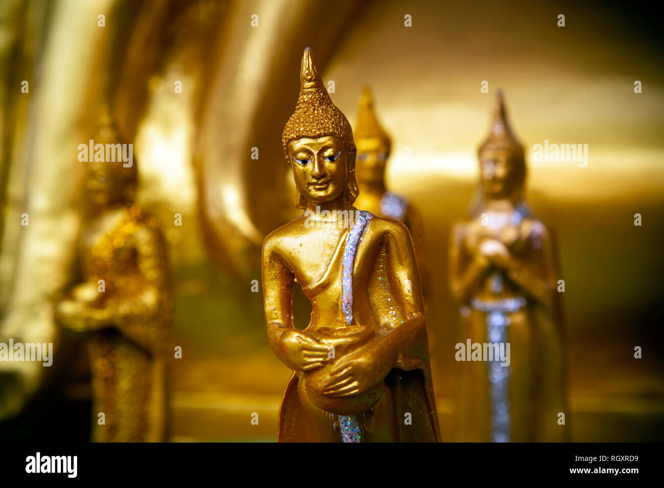 Closeup detail of small ornate gold buddha at Wat Phra Yai located on Pratumnak Hill in Pattaya, Chonburi, Thailand. - Stock Image