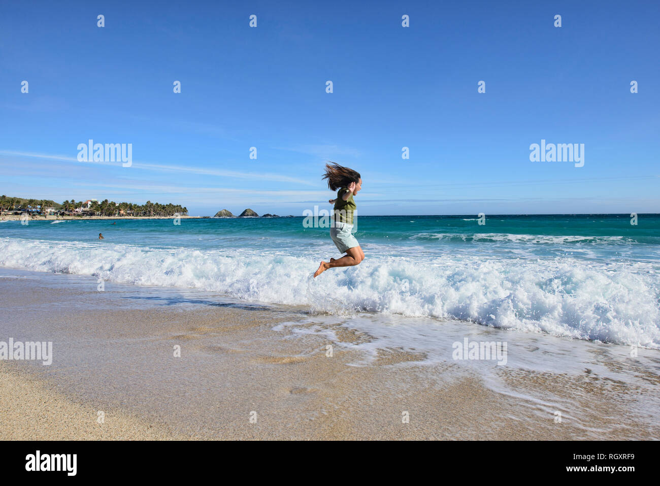 Jumpshot at the beautiful Blue Lagoon (Maira-ira) Beach, Pagudpud, Ilocos Norte, Philippines - Stock Image