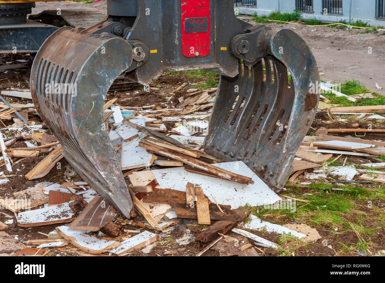 Demolition site. Sorting Grabs used to sort waste on a demolition site. Here wood piece recovery - Stock Image