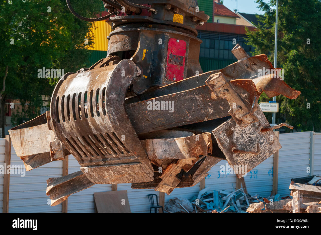 Demolition site. Sorting Grabs used to sort waste. Here recovery of iron girder. - Stock Image
