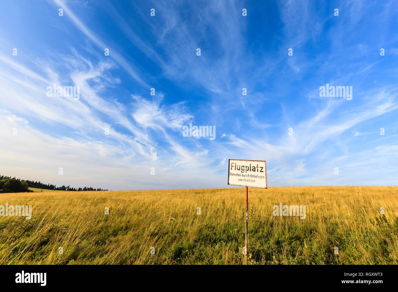 Airfield on the mountain tops (Wasserkuppe) with prohbitit sign 'Airfield unauthorized persons prohibited', biosphere, Rhoen, Hessen, Bavaria, Germany, Europe - Stock Image