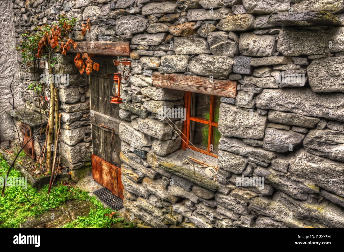 Rustic House in Stone Material in Ticino, Switzerland. - Stock Image