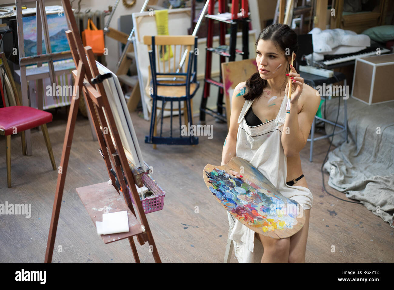 Woman Artist Painting Picture In Art Studio Female Artist