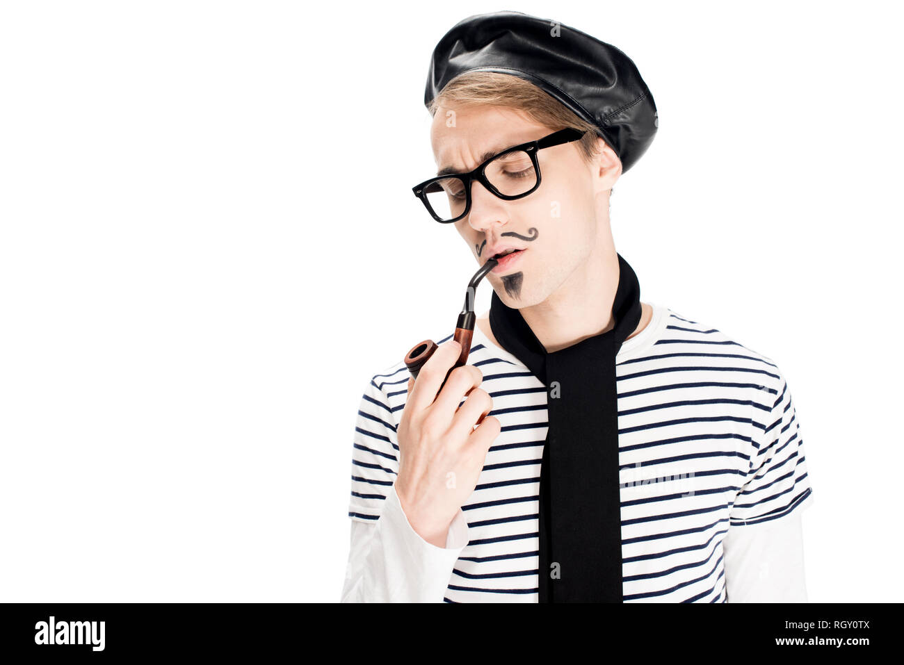 fe670ef4b307c handsome french man in glasses smoking pipe isolated on white - Stock Image