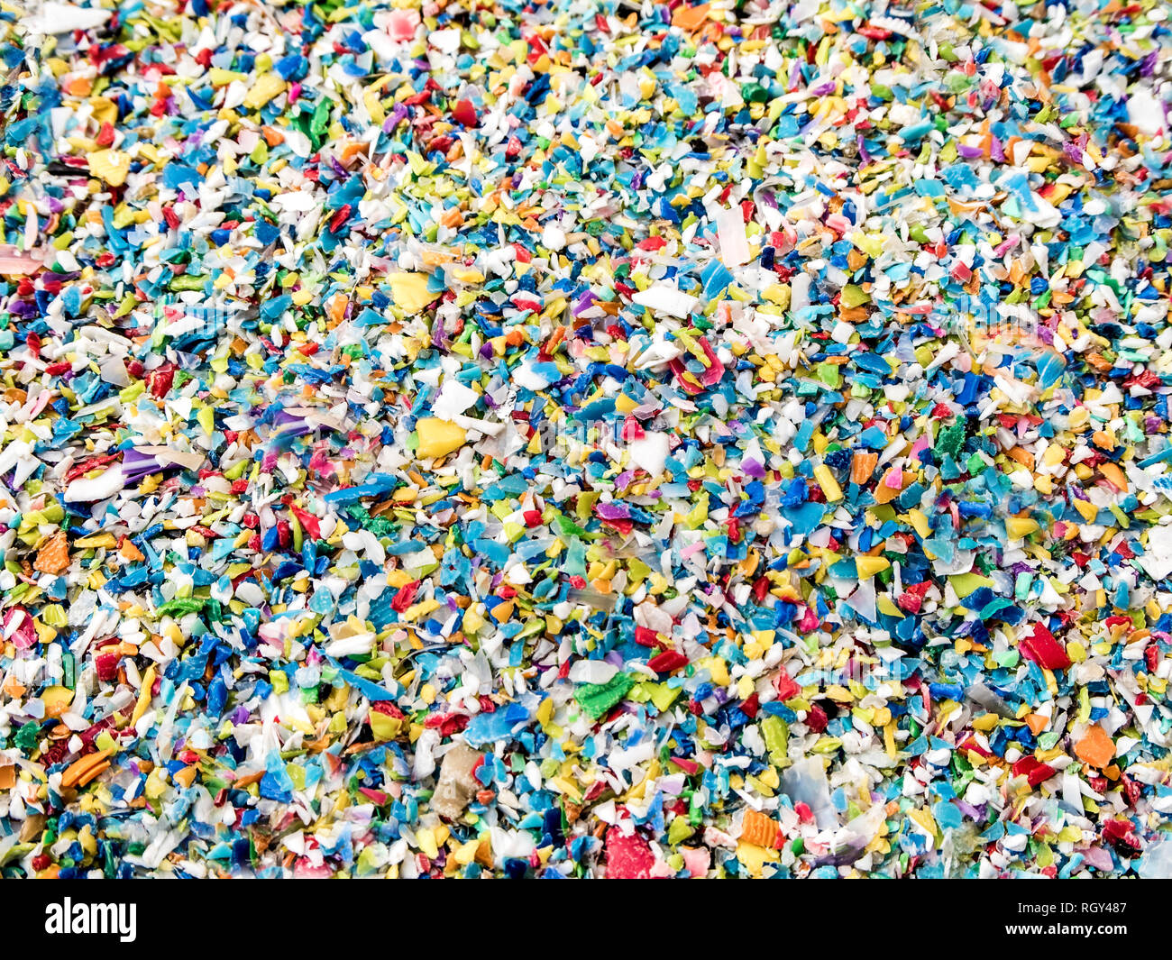 Used plastic crushed, Prepared to be re-melted into recycled plastic pellets - Stock Image