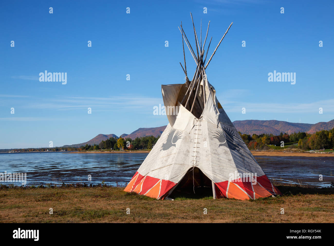 Gesgapegiag, Quebec, Canada - October 5, 2018: North American Indians Teepee near the Atlantic Ocean shore during a vibrant sunny day. - Stock Image
