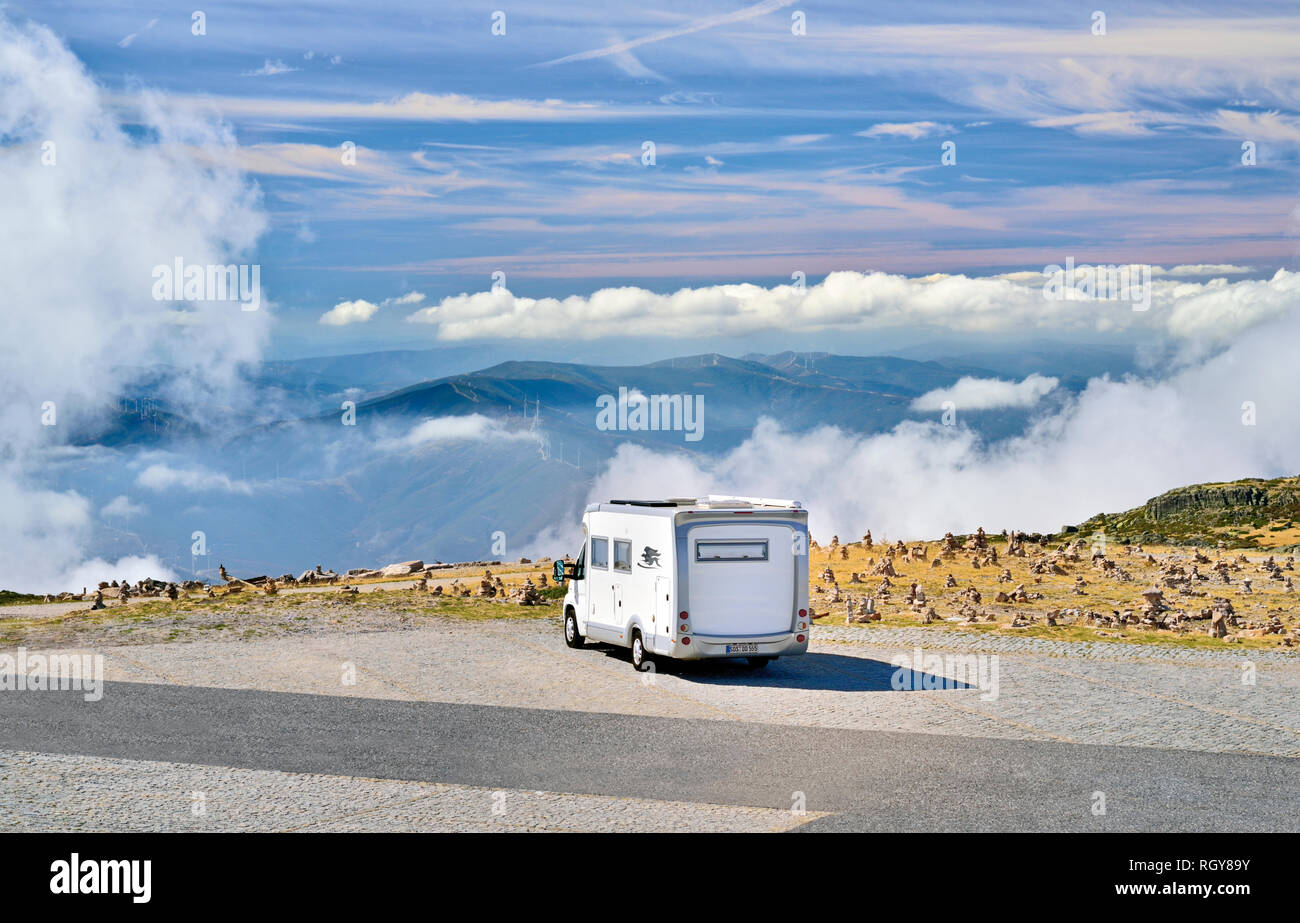 Motorhome parking above the clouds on mountain parking spot - Stock Image