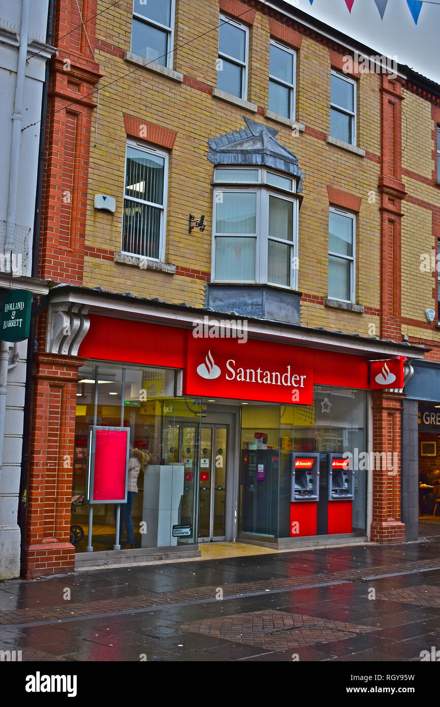 The Bridgend (Adare Street) branch of Santander bank. Cash machines inside and outside. Town Centre, Bridgend, S.Wales UK - Stock Image