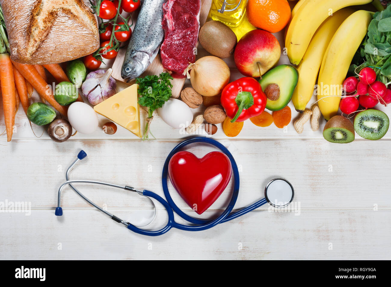 Healthy Lifestyle And Healthcare Concept Healthy Food Heart And Stethoscope Stock Photo Alamy