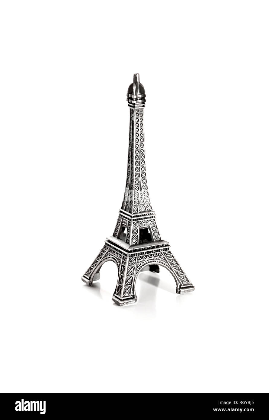 small copy of eiffel tower on white background - Stock Image
