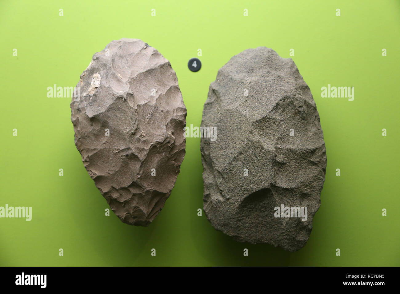 Ancient hunters of the grasslands. Early Stone Age. Hand-axes - Stock Image