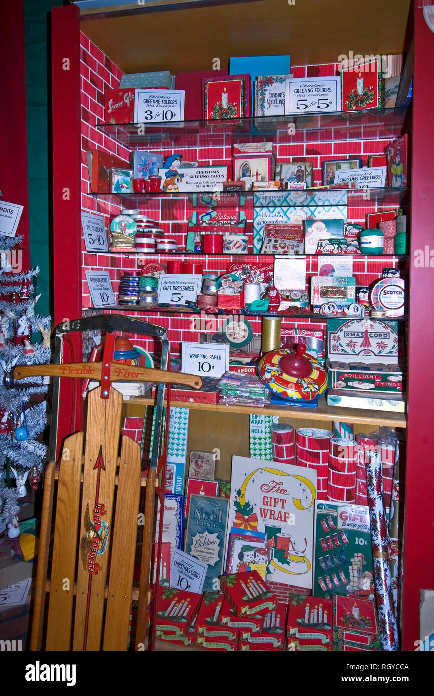 old shop Christmas display; Five and Dime; Flexible Flyer wood sled; inexpensive prices; holiday items for sale; vertical, PR - Stock Image