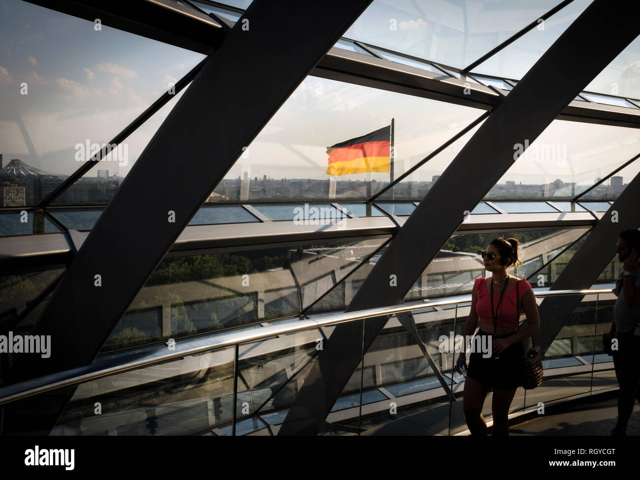 An interior view of the dome in the Reichstag building in Berlin. The historical seat of Germany's parliament since the time of the Holy Roman Empire, it was damaged during Word War II. The ruined building was made safe against the elements and partially refurbished in the 1960s, but no attempt at full restoration was made until after German reunification on 3 October 1990, when it underwent a reconstruction led by architect Norman Foster. After its completion in 1999, it once again became the meeting place of the German parliament: the modern Bundestag. Stock Photo