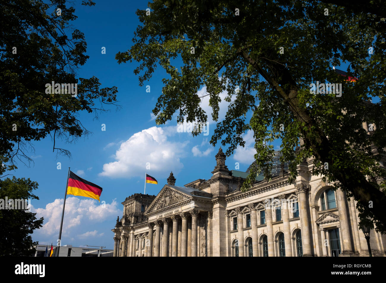 An exterior view of the Reichstag building in Berlin. The historical seat of Germany's parliament since the time of the Holy Roman Empire, it was damaged during Word War II. The ruined building was made safe against the elements and partially refurbished in the 1960s, but no attempt at full restoration was made until after German reunification on 3 October 1990, when it underwent a reconstruction led by architect Norman Foster. After its completion in 1999, it once again became the meeting place of the German parliament: the modern Bundestag. Stock Photo