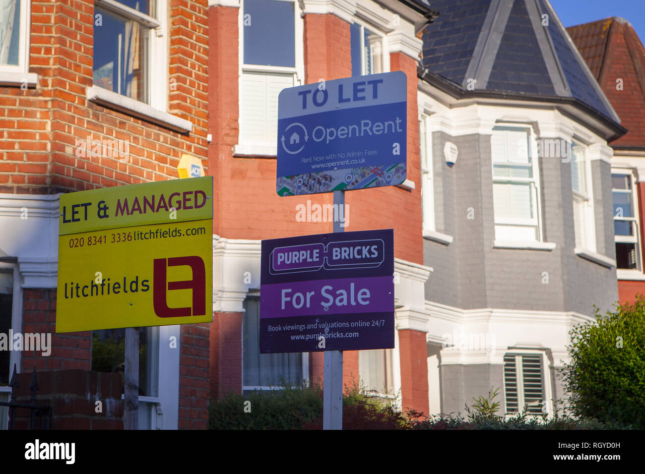 For Sale and To Let signs for house in sunlight Stock Photo