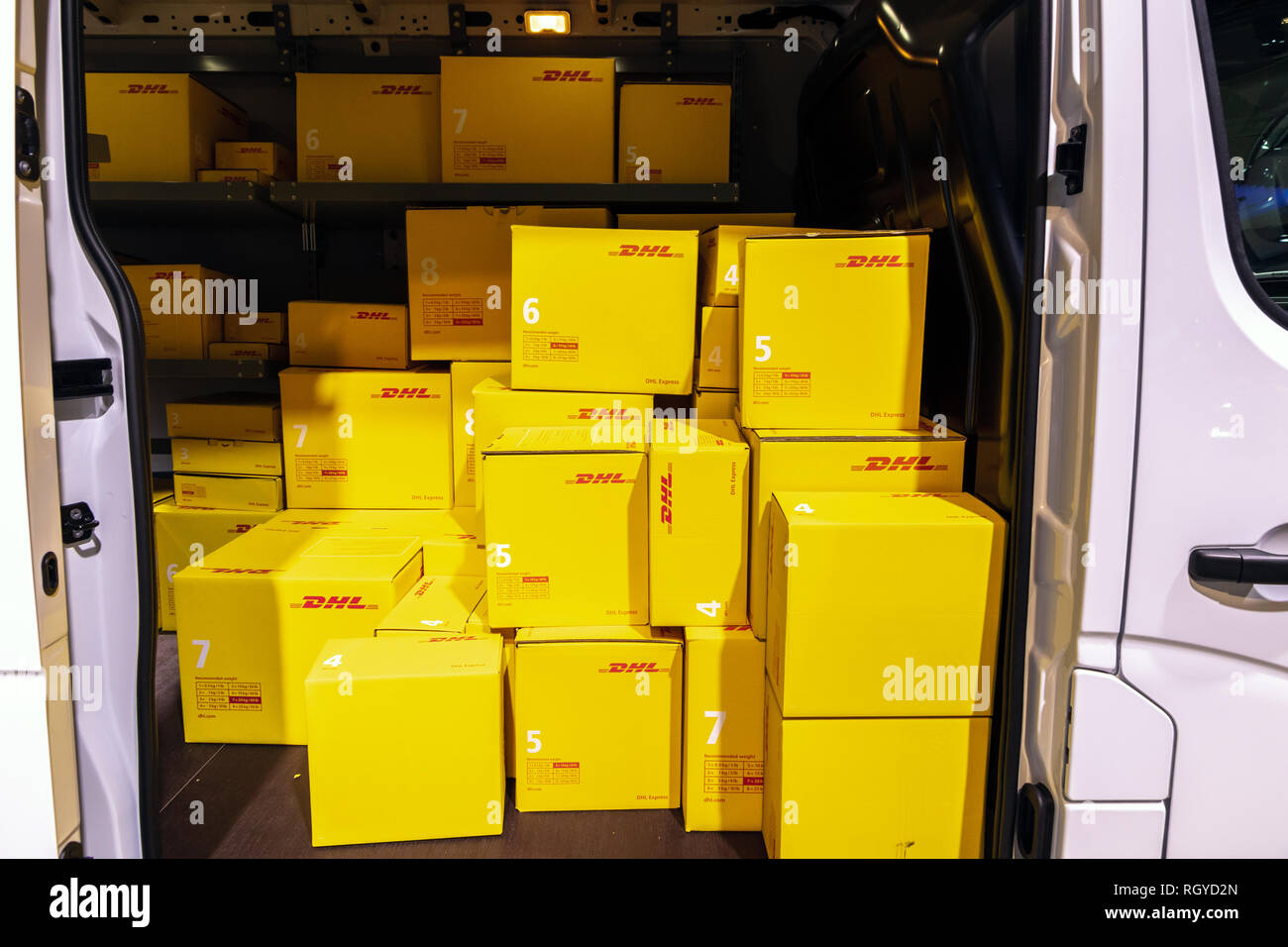 BRUSSELS - JAN 18, 2019: DHL delivery van showcased at the 97th Brussels Motor Show 2019 Autosalon. - Stock Image