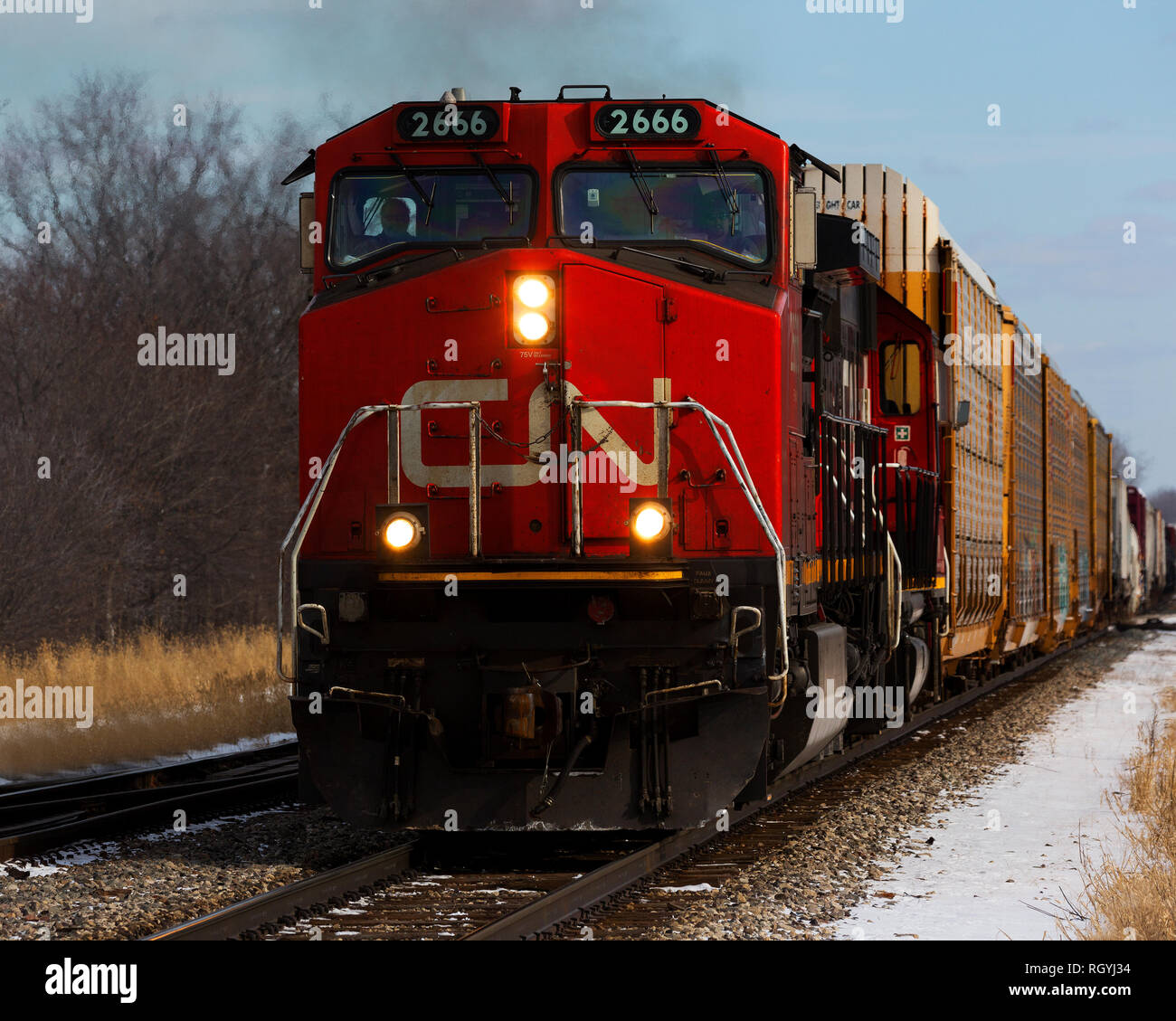 Canadian National Railway #2666 hauling freight through Durand, Michigan in winter - Stock Image
