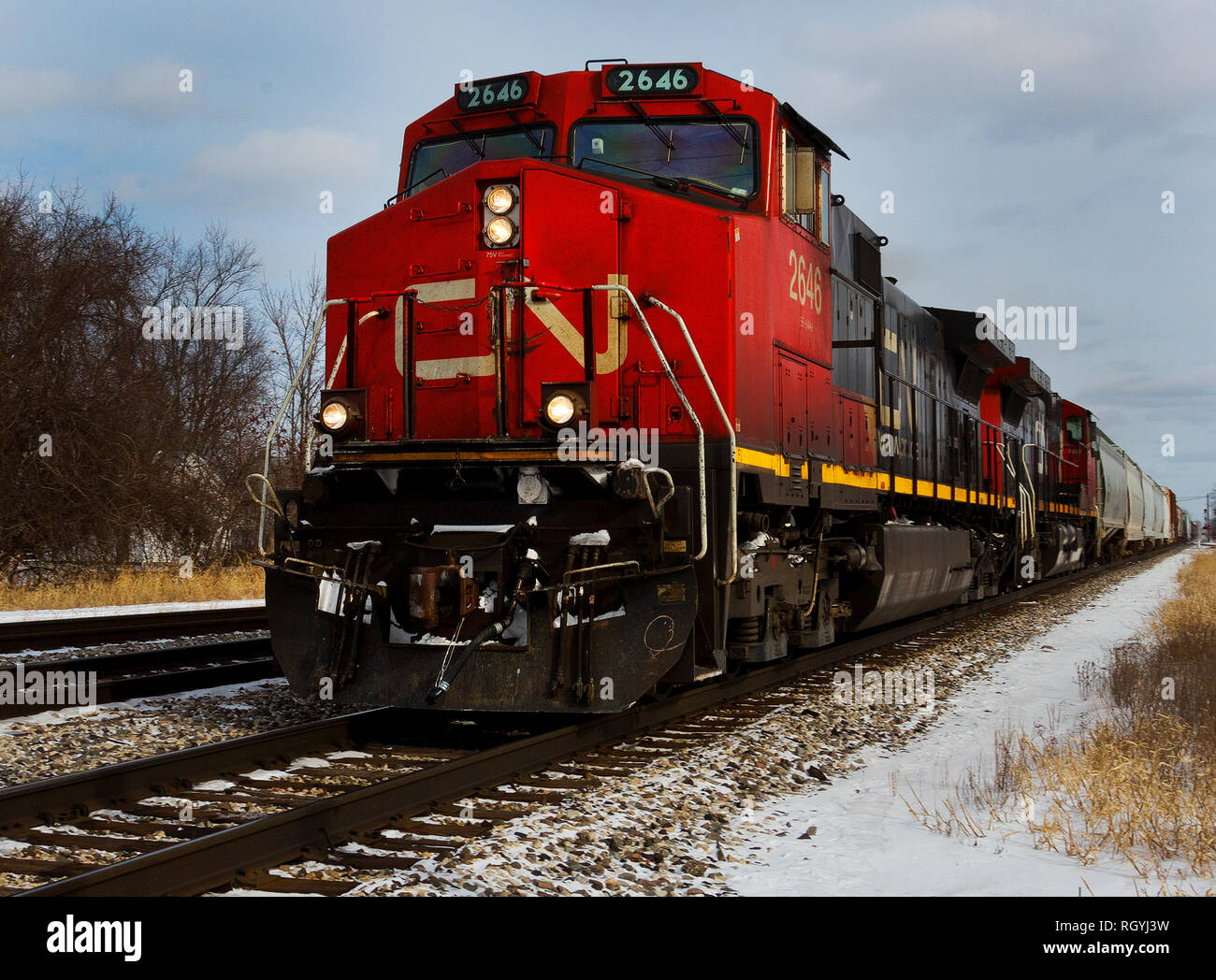 Canadian National Railway #2646 hauling freight through Durand, Michigan in winter - Stock Image