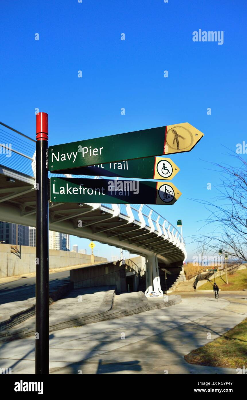 Chicago, Illinois, USA. Directional signs along the city's Lakefront Trail in Jane Addams Memorial Park near Navy Pier. - Stock Image