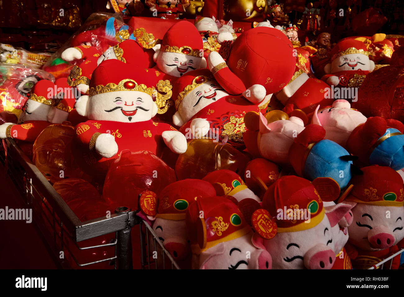 Red-clothed dolls for sale in Singapore on occasion of Chinese New Year; among Chinese, the color red is deemed auspicious - Stock Image