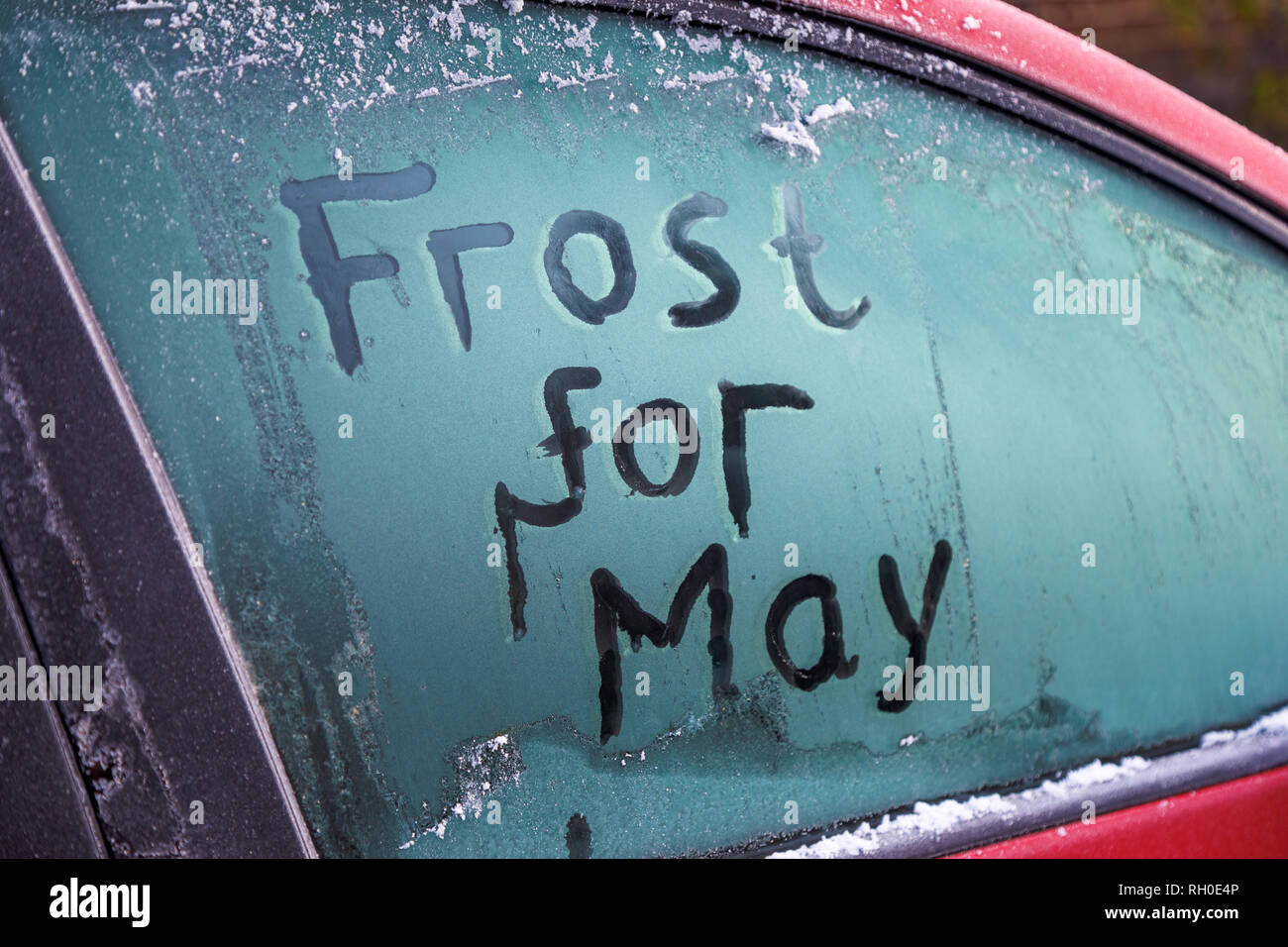 Woking, Surrey, south-east England, UK, 31st January 2019. UK Weather:  'Frost for May': A message is written on a frozen car window in the morning after the coldest night in the UK so far this winter as Prime Minister Theresa May prepares to renegotiate the UK's Brexit agreement with EU negotiators.  Credit: Graham Prentice/Alamy Live News. - Stock Image
