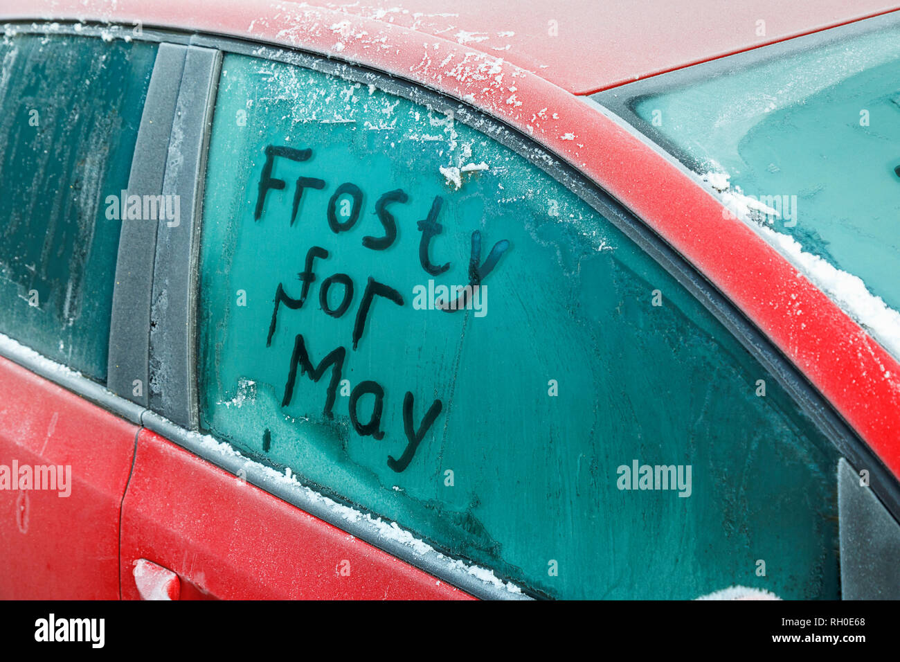 Woking, Surrey, south-east England, UK, 31st January 2019. UK Weather:  'Frosty for May': A message is written on a frozen car window in the morning after the coldest night in the UK so far this winter as Prime Minister Theresa May prepares to renegotiate the UK's Brexit agreement with EU negotiators.  Credit: Graham Prentice/Alamy Live News. - Stock Image