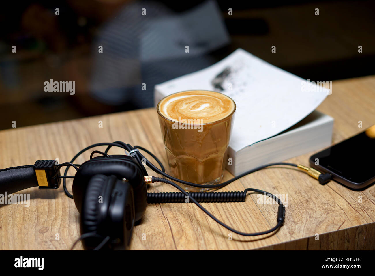 Hot Coffee, muisc and reading a book on the table - Stock Image