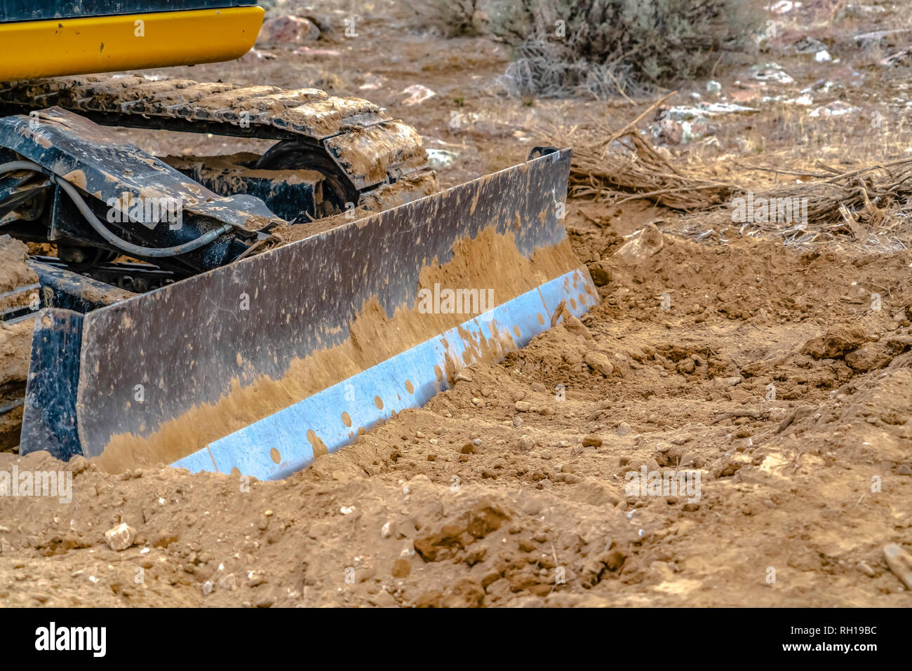 Grader blade attached to excavator in Utah Valley - Stock Image