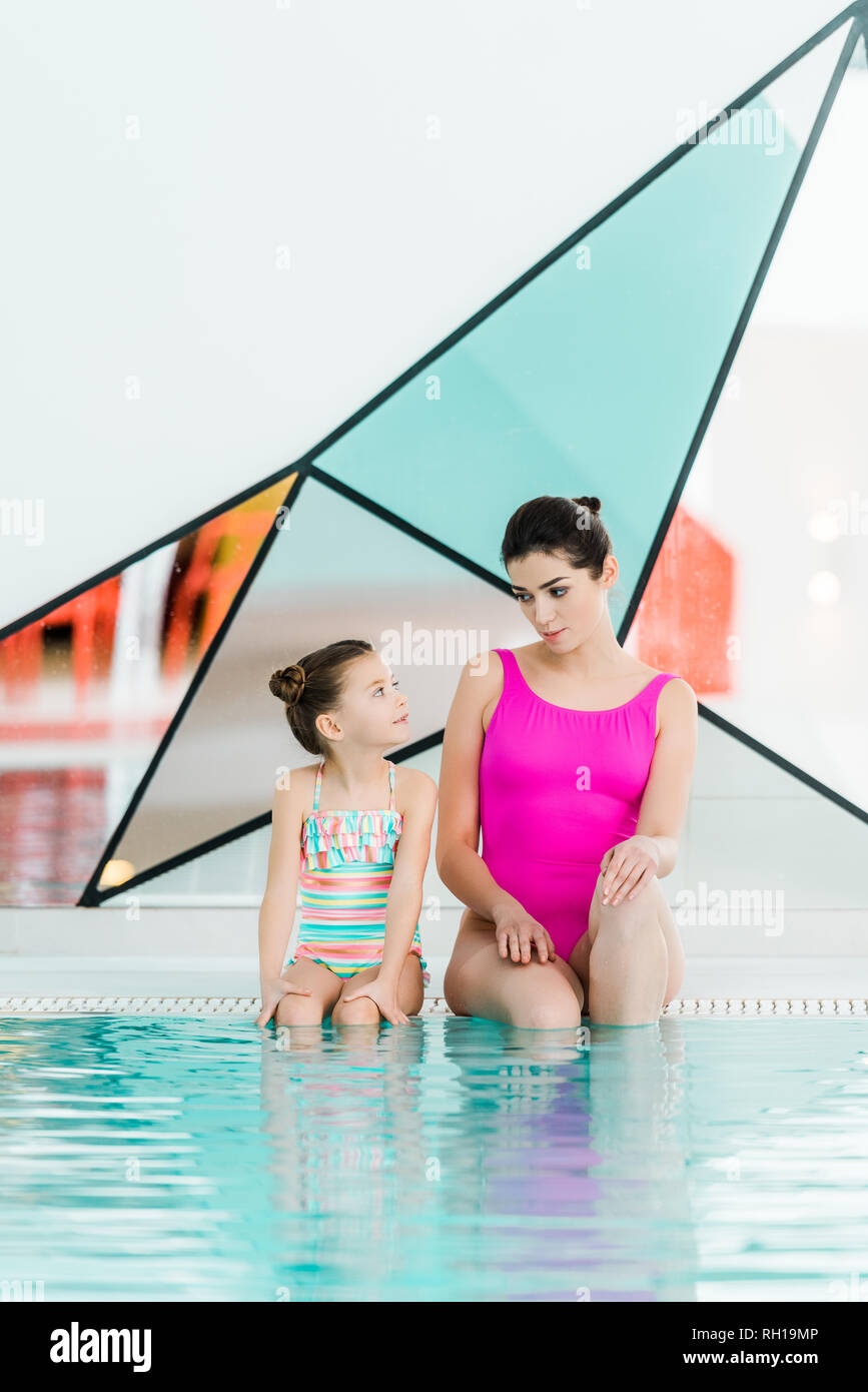 Mother daughter near swimming pool stock photos mother - Where is my nearest swimming pool ...