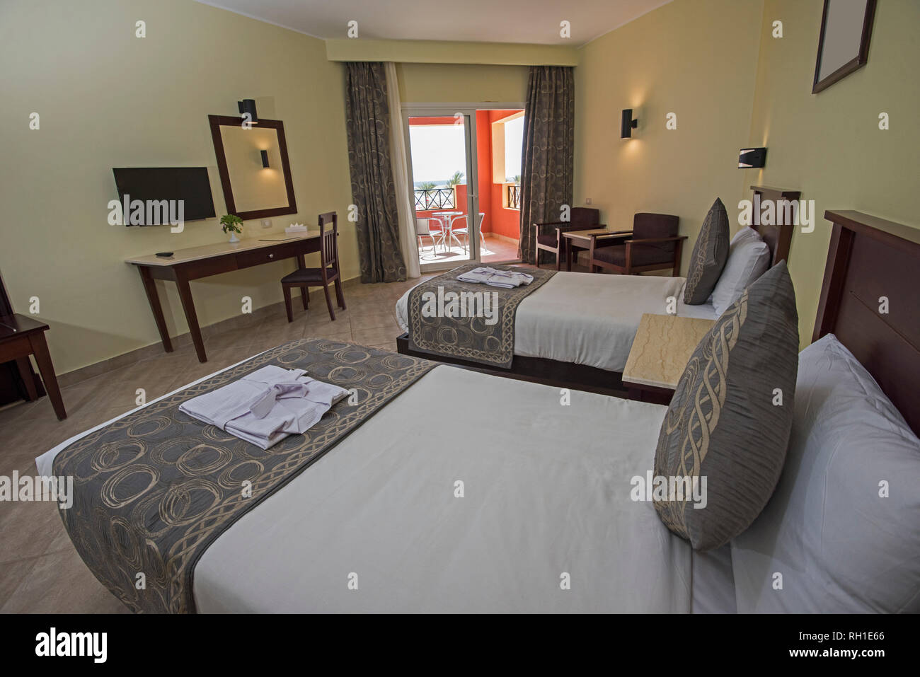 Twin Beds In A Luxury Hotel Resort Room With Curtains And Balcony Door Stock Photo Alamy