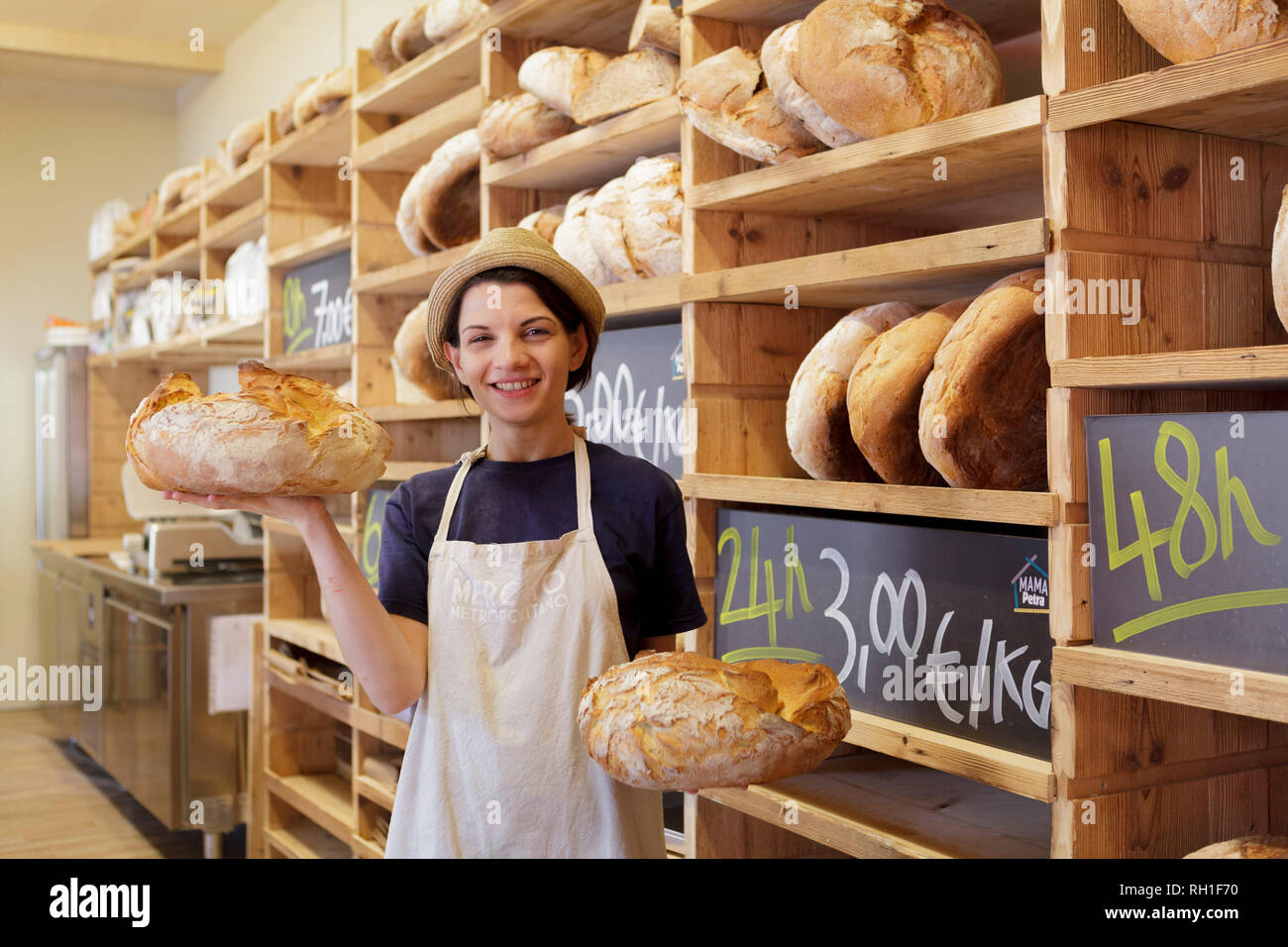 girl holding bread, mercato metropolitano, milan, italy - Stock Image