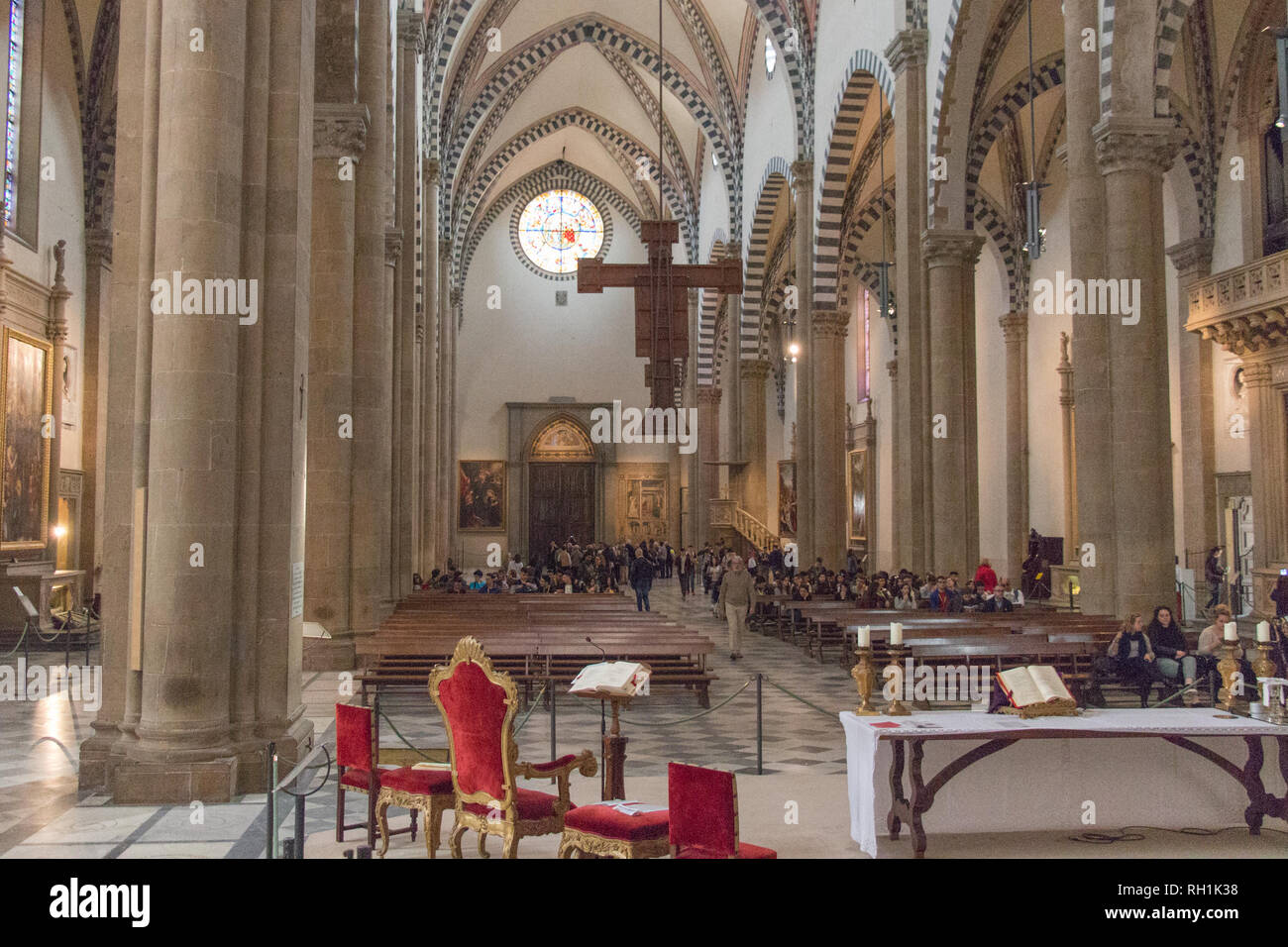 Italy, Florence - April 02 2017: the view of the Nave with the Crucifix of Giotto inside of Santa Maria Novella Church on April 02 2017, Tuscany. Stock Photo