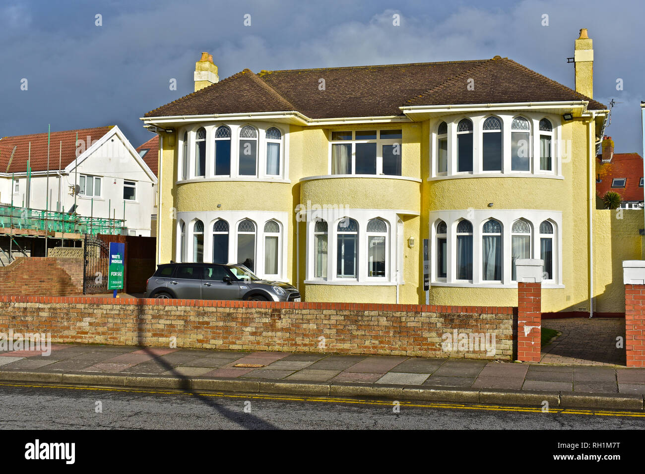 Double fronted with bay windows private house overlooking the sea at West Drive in Porthcawl. Property is for sale at time image was taken. - Stock Image