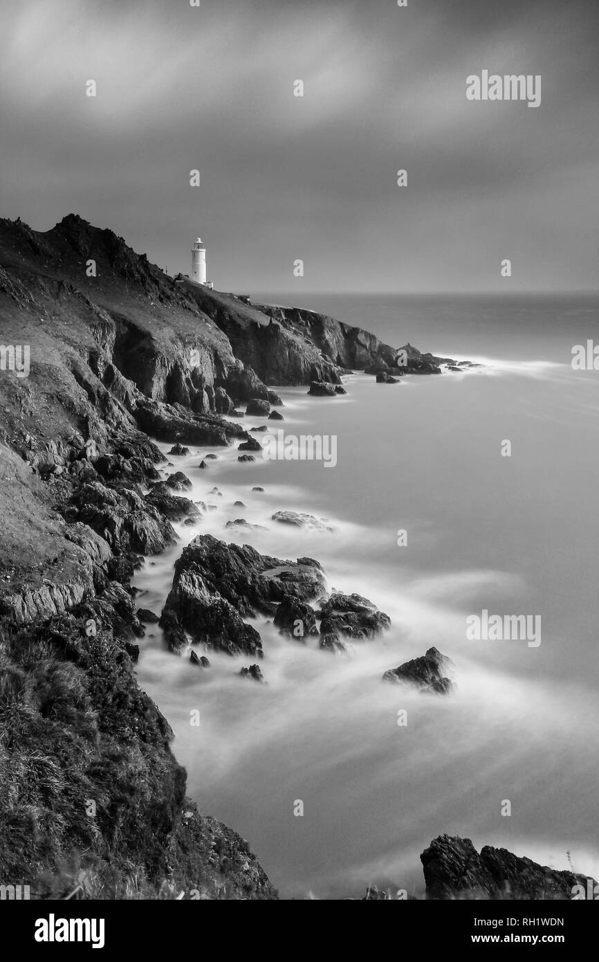 Start Point Lighthouse in Devon. Black and white slow exposure photograph. - Stock Image