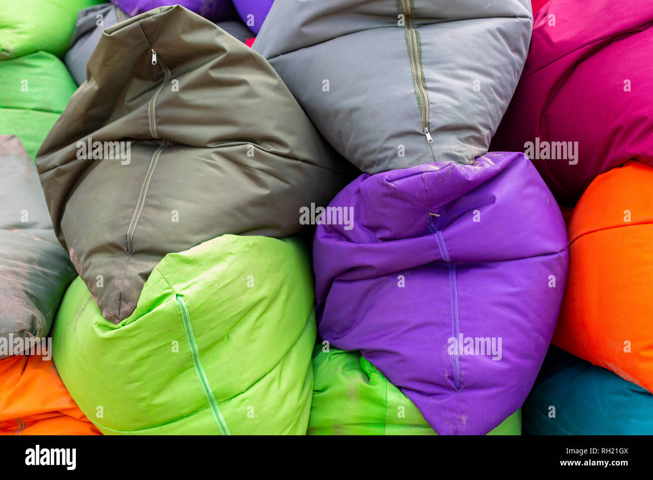 Vibrant and colorful bean bags on a seminyak beach bali on 11th december 2018 - Stock Image