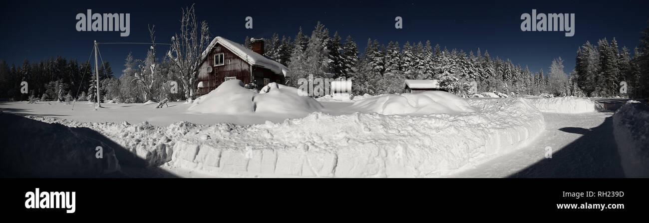 Swedish farm buildings in clear winter night. - Stock Image