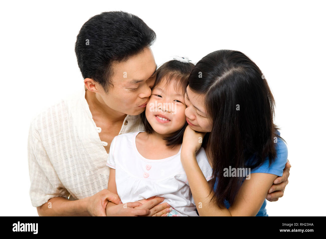 Asian family portrait on white background asian parents kissing daughter