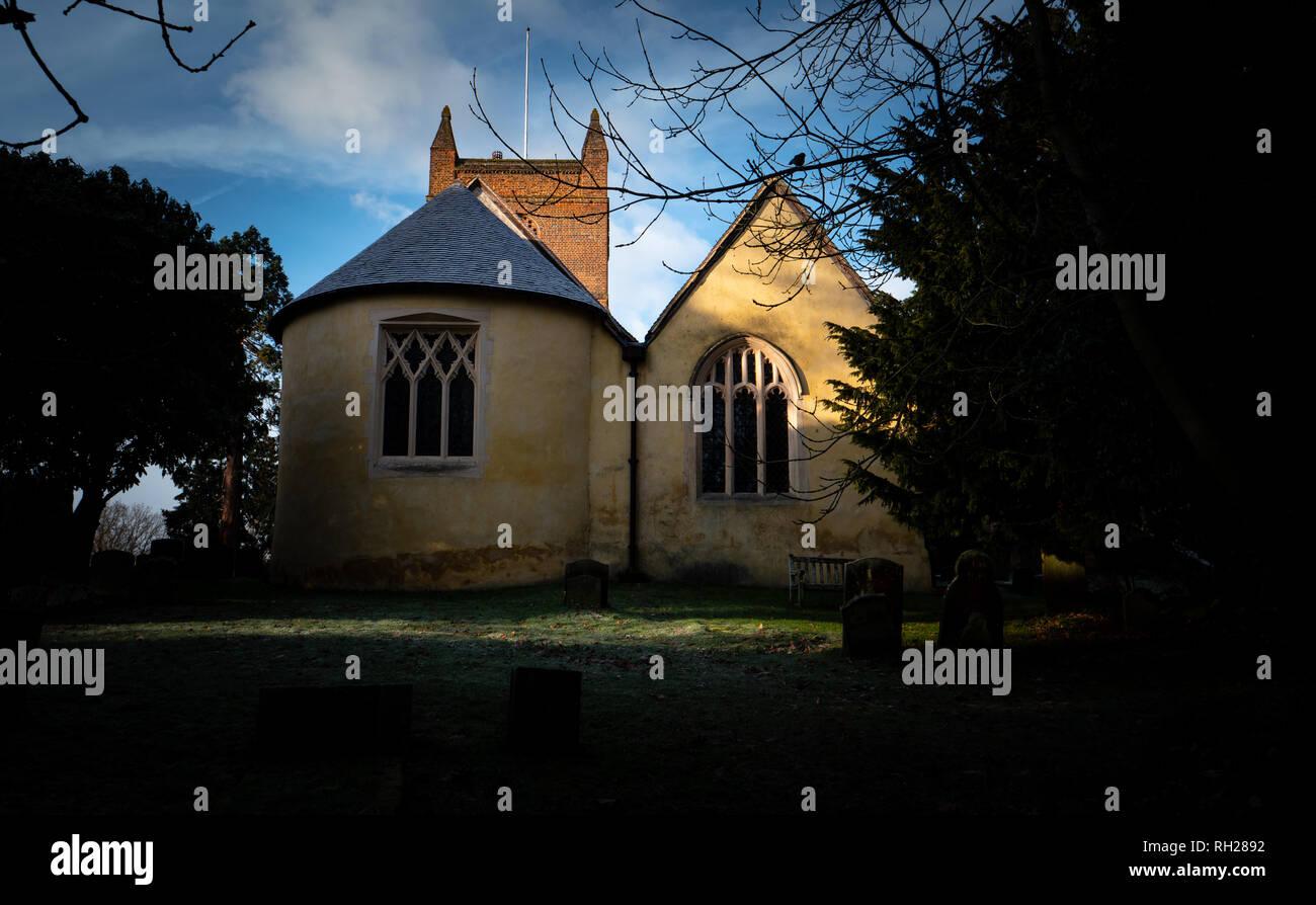 English village church in early morning sunlight Stock Photo