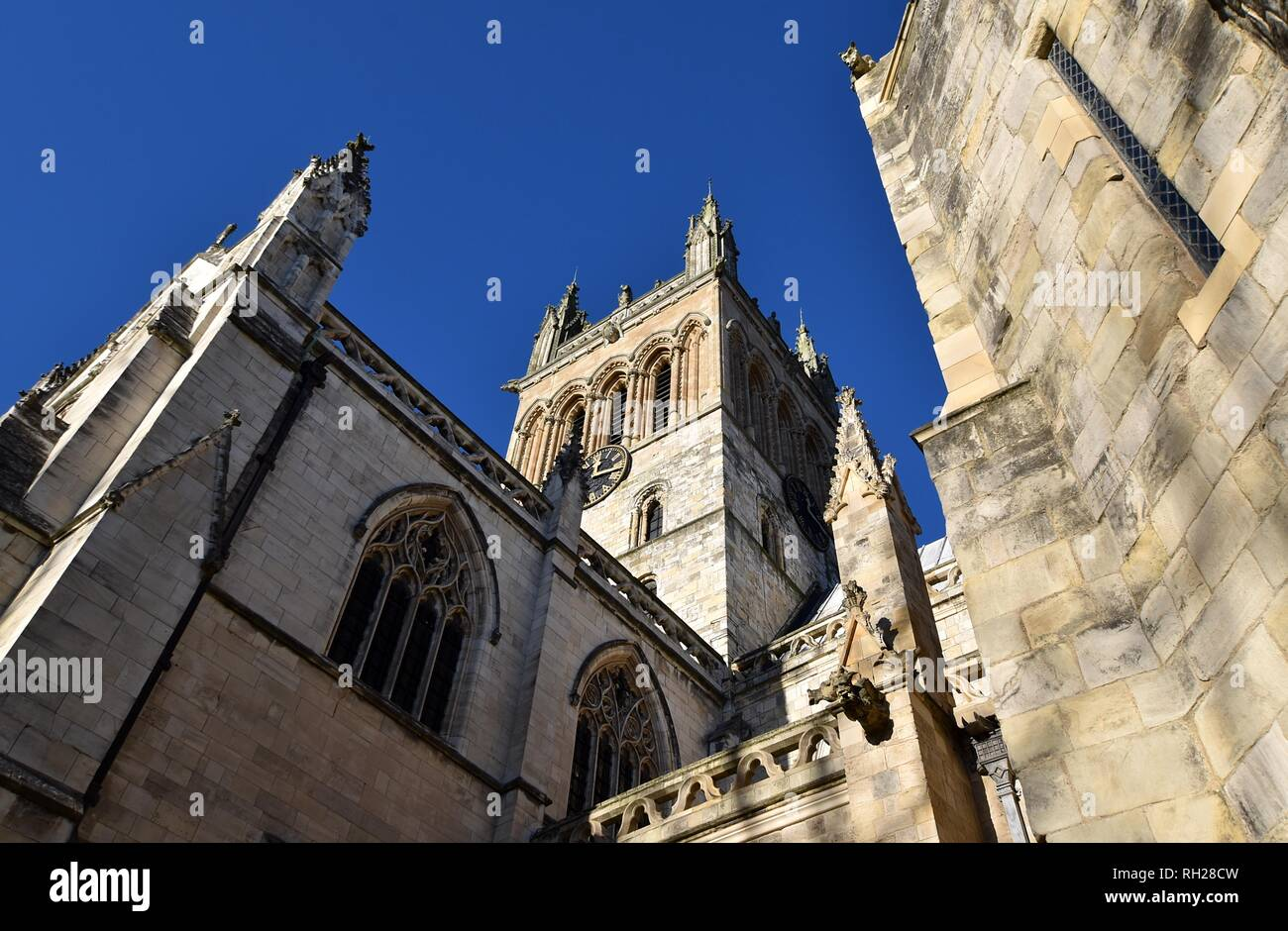 Clock Tower and Grotesques at Selby Abbey - Stock Image