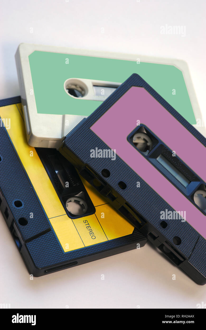 three vintage audio tapes on white background with color labels - Stock Image