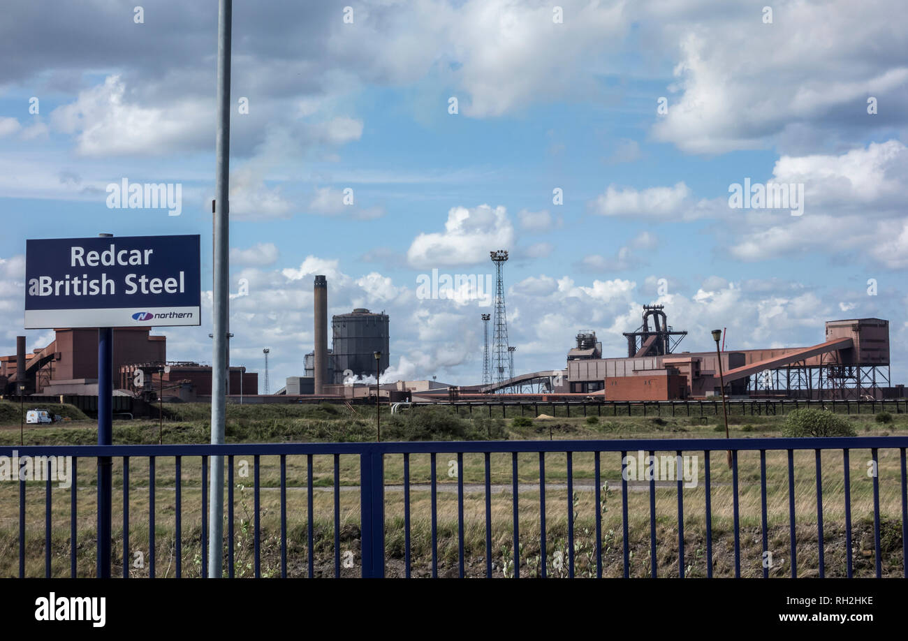 Train station at Redcar British Steel with blast furnace in background. Redcar, England, UK. The least used station in Britain 2017-18 - Stock Image