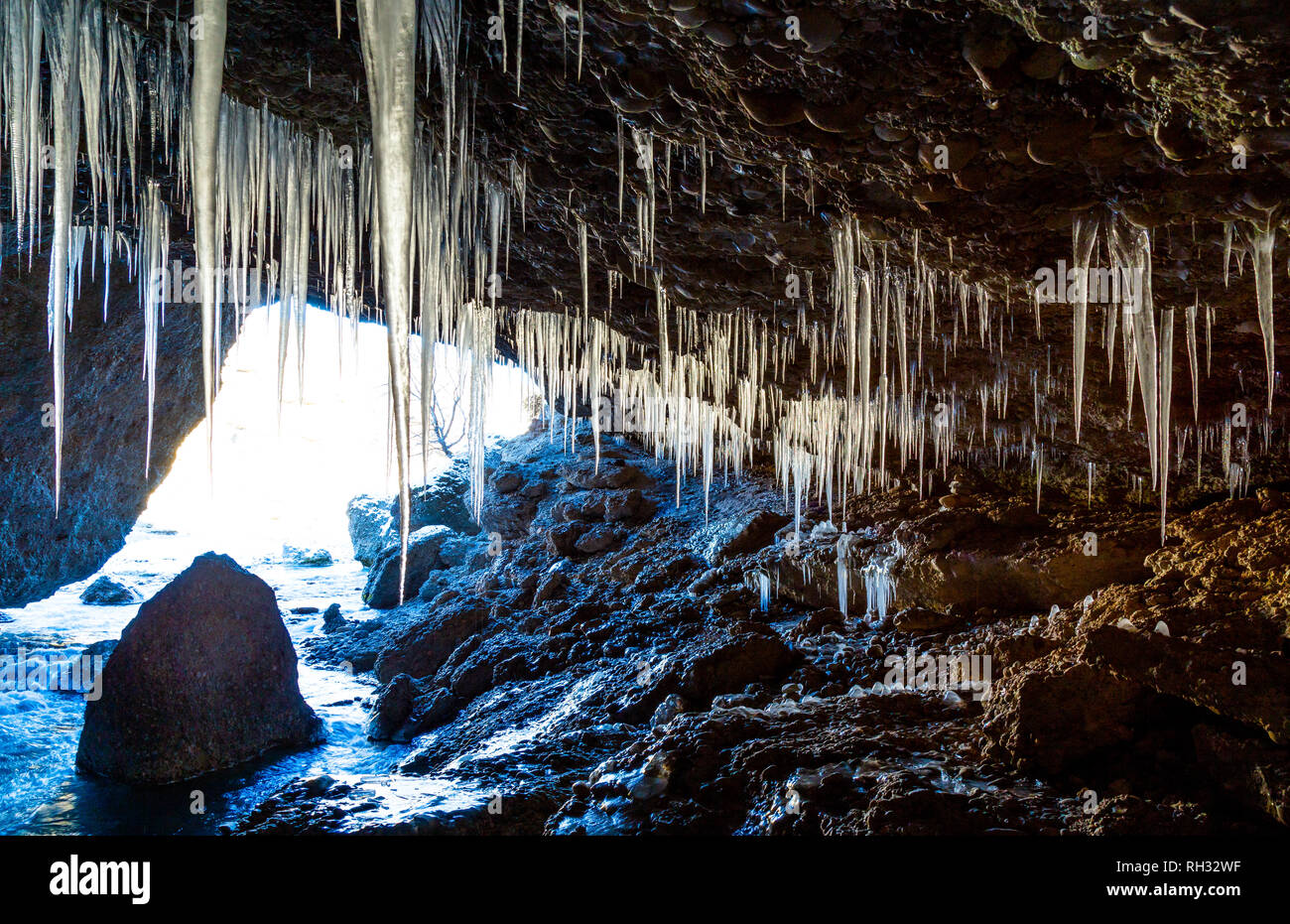 Panorama of the Cave with ice stalactites. - Stock Image